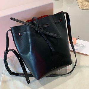 Mansur Gavriel bucket bag in black + red interior